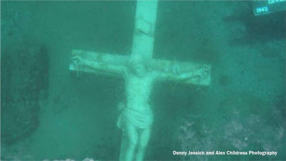 Giant underwater crucifix draws hundreds to frozen Lake Michigan