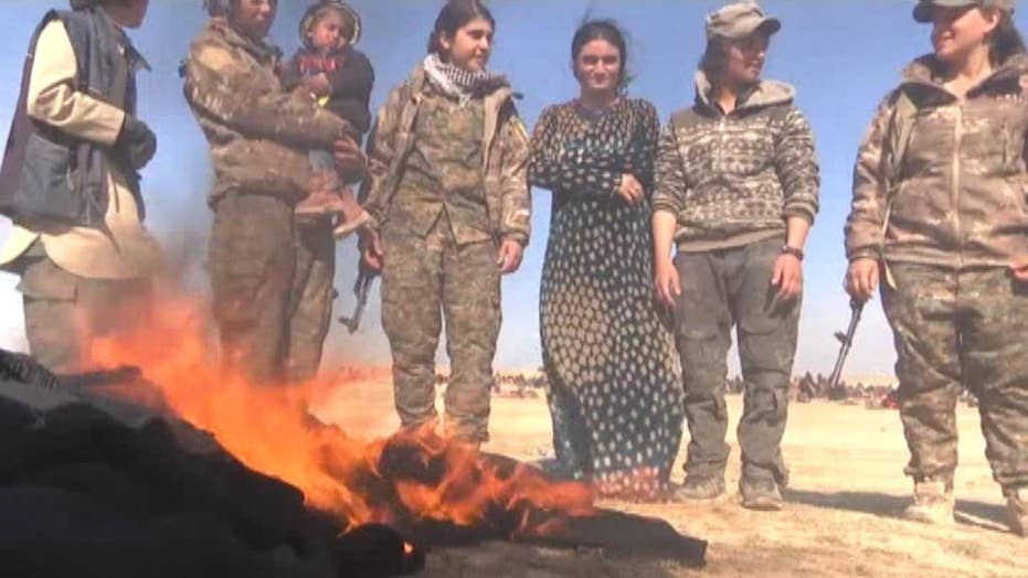 Yazidi sex slaves set fire to their burqas after being freed from ISIS