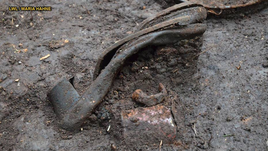 Hundreds of chilling items discovered at Nazi massacre sites