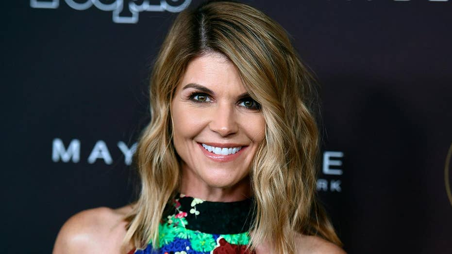 Actress Lori Loughlin taken into custody over college admissions scandal