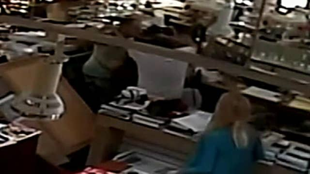 Security camera catches brawl between a jewelry store owner and a would-be thief