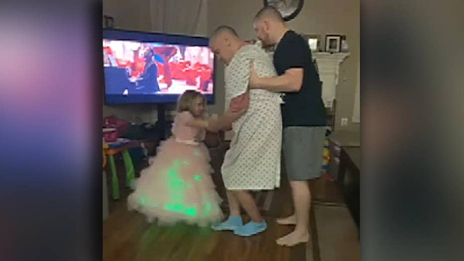 Alzheimer's patient dances with his 3-year-old granddaughter