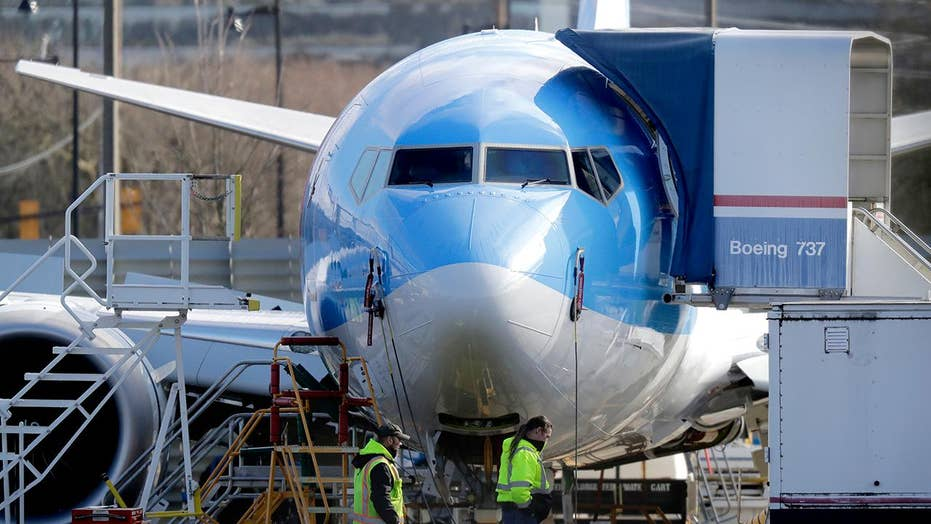 Boeing under pressure as its 737 Max aircraft sit idle
