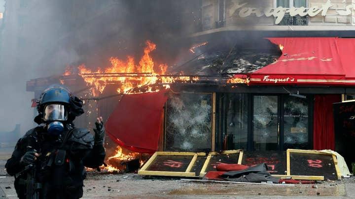 Protestors set fire to bank in Paris, France