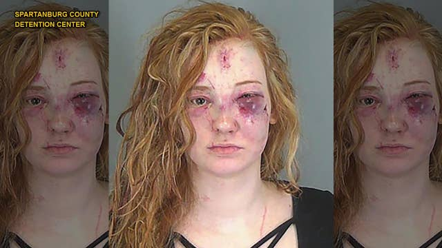 Woman arrested after tasing rival; mugshot shows she paid price