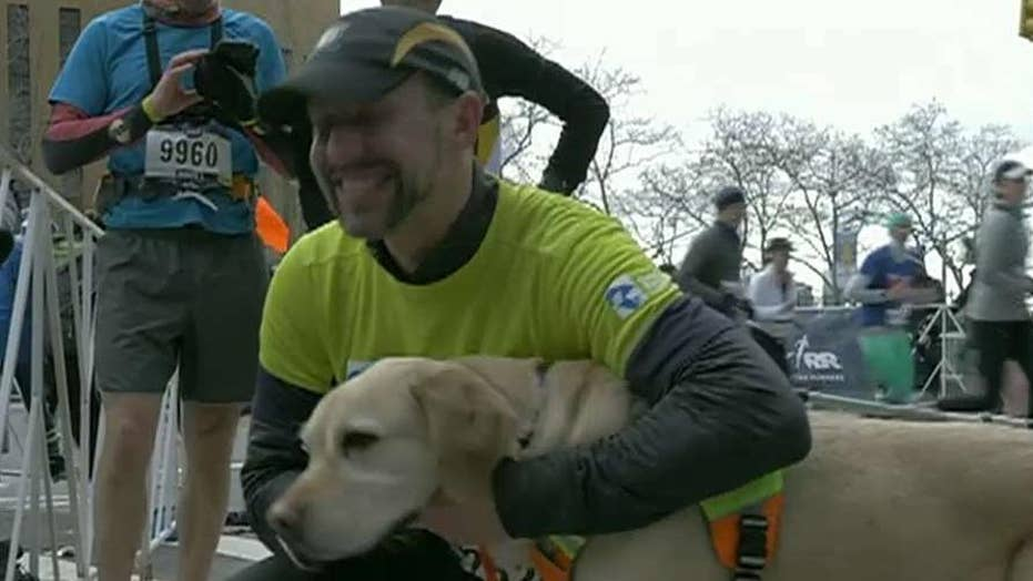 Blind runner and guide dogs make history at NYC half marathon