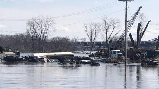 Flooding in midwest states causes devastation for miles