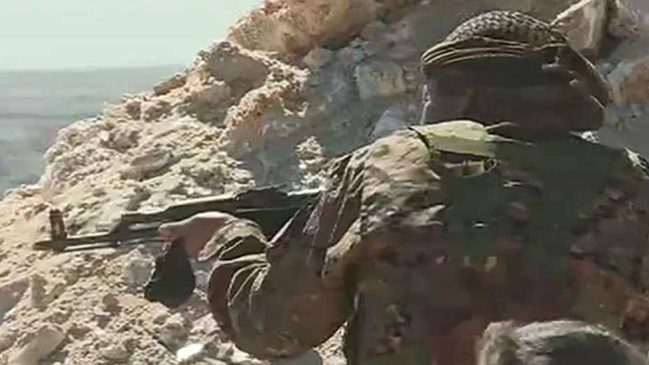 View from the front: US-backed forces fight ISIS soldiers at remaining stronghold in eastern Syria