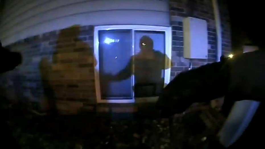 Police officers in Des Moines, Iowa, catch children as the leap a burning apartment building