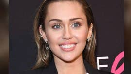 Miley Cyrus marks National Puppy Day with another nude photo – this time with a dog