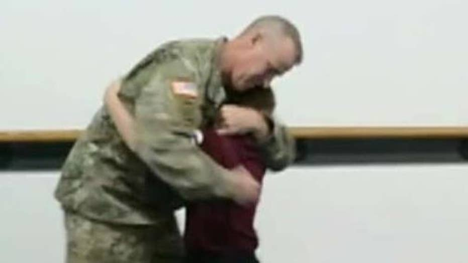 Father deployed with the Army National Guard returns to surprise his son at taekwondo class
