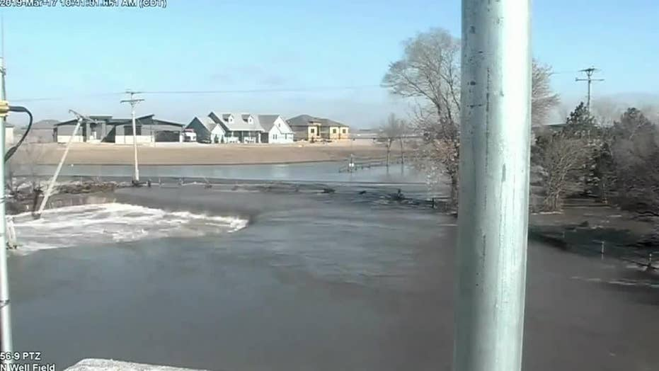 Water from Thomas Lake floods the city of Lincoln, Nebraska