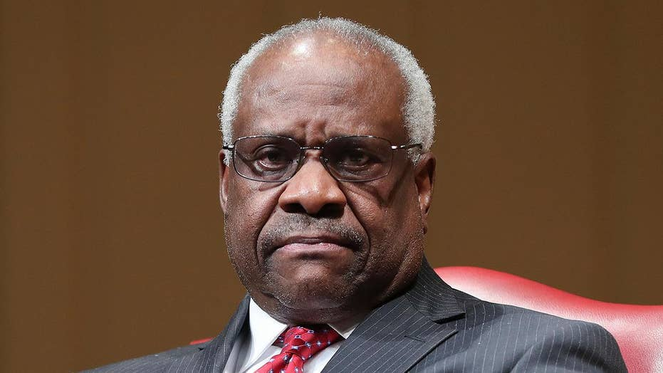 Supreme Court Justice Clarence Thomas, for first time in years, speaks during arguments