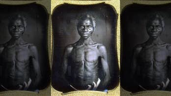 Harvard sued for 'exploiting' early photos of slaves, asked to pay damages to woman who says she's next of kin