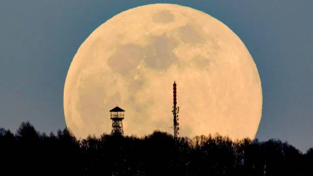 'Full worm supermoon' lights up the sky in stunning pictures