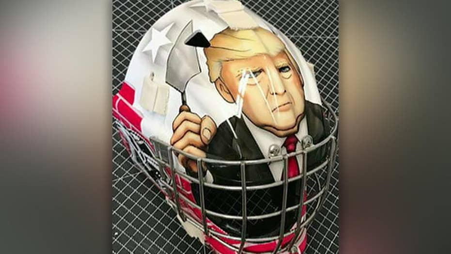 Youth hockey mask features President Trump building a wall