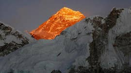Melting Mount Everest glaciers reveal dead climbers' bodies: report