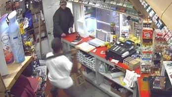 WATCH: Store clerk's machete fends off knife-wielding robbery suspects