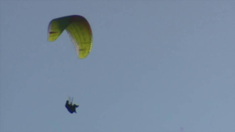 Hikers call 911 after capturing video of paraglider falling toward