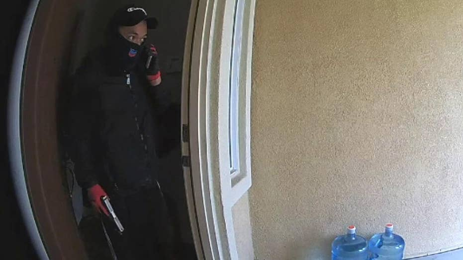 Home surveillance camera captures two men stealing from a California home