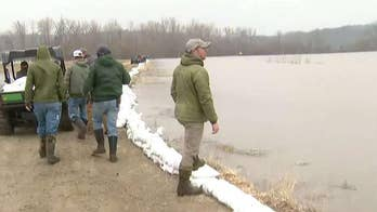 Army of flood fighters at work in Missouri as waters threaten farms