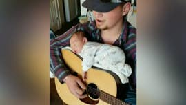 Aspiring country star uses guitar to lull baby daughter to sleep in viral video