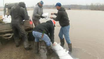Communities come together to fend off record flooding in Missouri