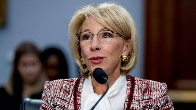 DeVos on defense for cutting Special Olympics funding