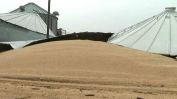 Flooding explodes farmers' grain silos in Iowa