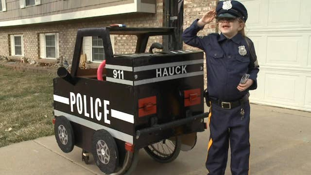Dad converts wheelchair into police cruiser for daughter with an epileptic condition