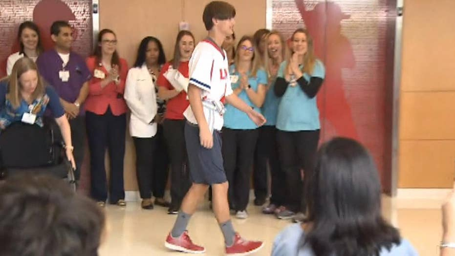Paralyzed lacrosse player walks out of hospital