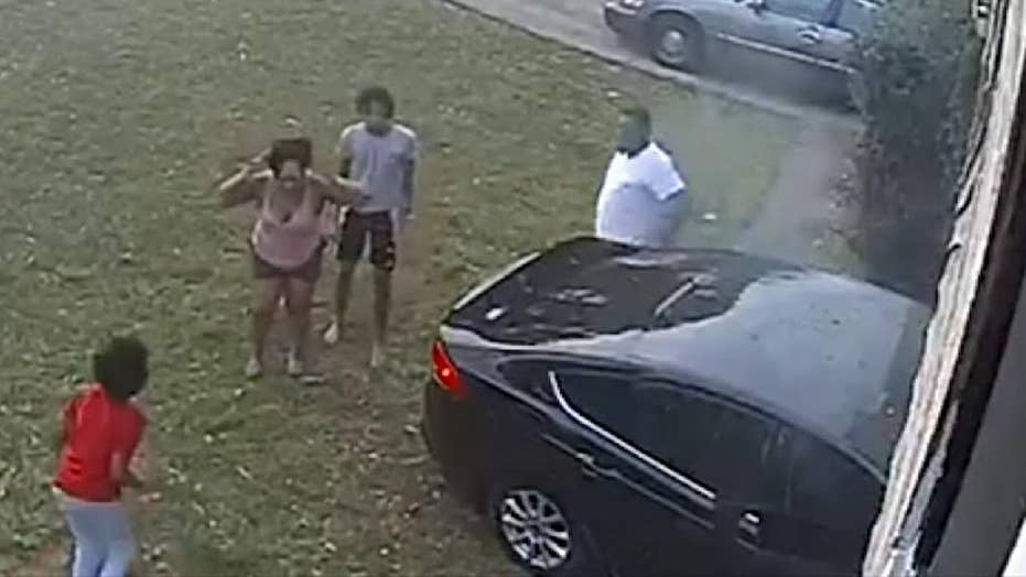 Graphic content: Speeding car hits young girl playing in her front yard.
