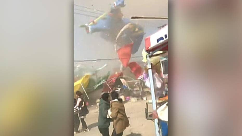 Two children killed after dust devil launches bounce house into air in China