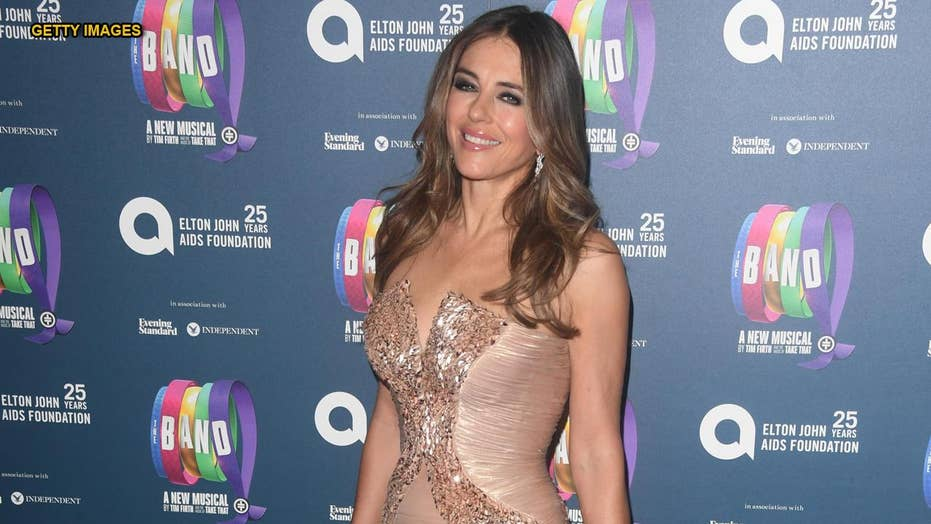 Elizabeth Hurley, 55, reveals another throwback bikini snap: 'Cheer yourself up in these miserable times'