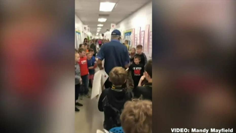 Students at a Georgia elementary school hold a heartwarming 80th birthday bash for the school janitor