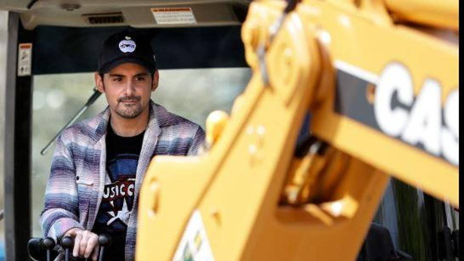 Country star Brad Paisley begins construction on space that will become a free grocery store to support needy families
