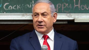Netanyahu shows slight edge in bid for reelection, exit polls indicate