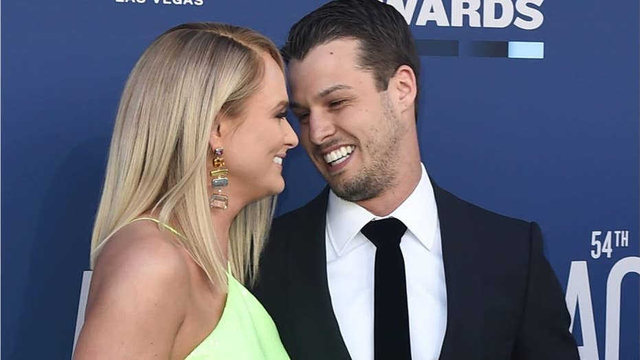 Miranda Lambert, husband Brendan McLoughlin display PDA on 2019 ACM Awards red carpet