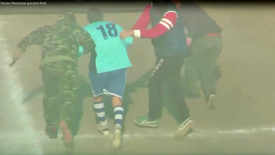Retiring Italian soccer player escorted from final match into helicopter by masked men