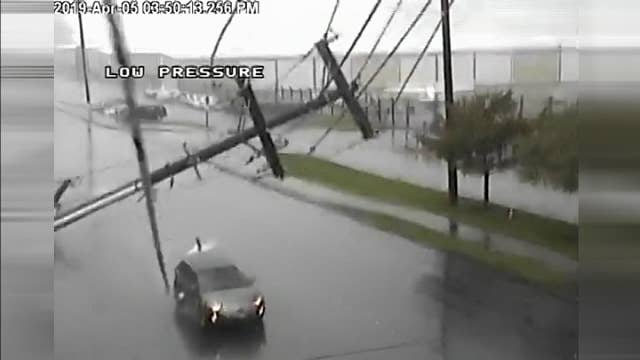 Couple survives power line pole impaling SUV in Seattle