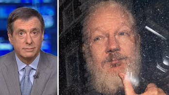 Julian Assange, arrested for damaging leaks, claims to be a journalist