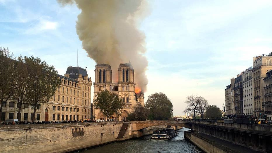 Firefighters struggle to contain massive blaze at Notre Dame Cathedral in Paris