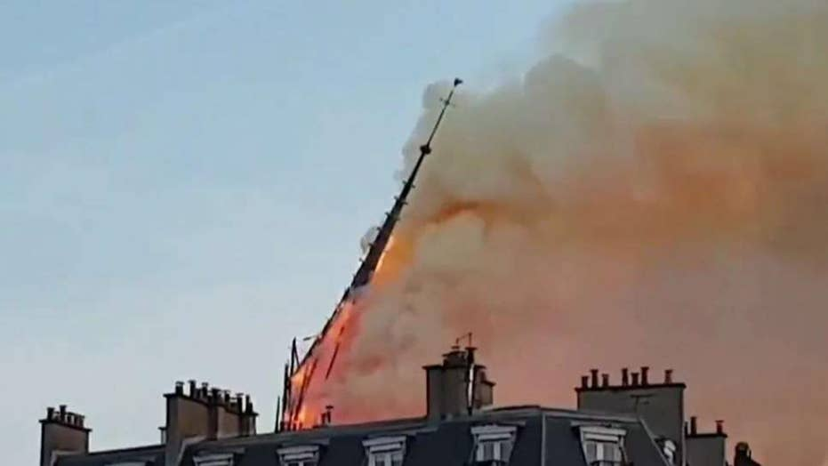 Notre Dame spire collapses during massive fire