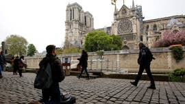 Family from viral Notre Dame Cathedral photo found, dad chooses to stay anonymous