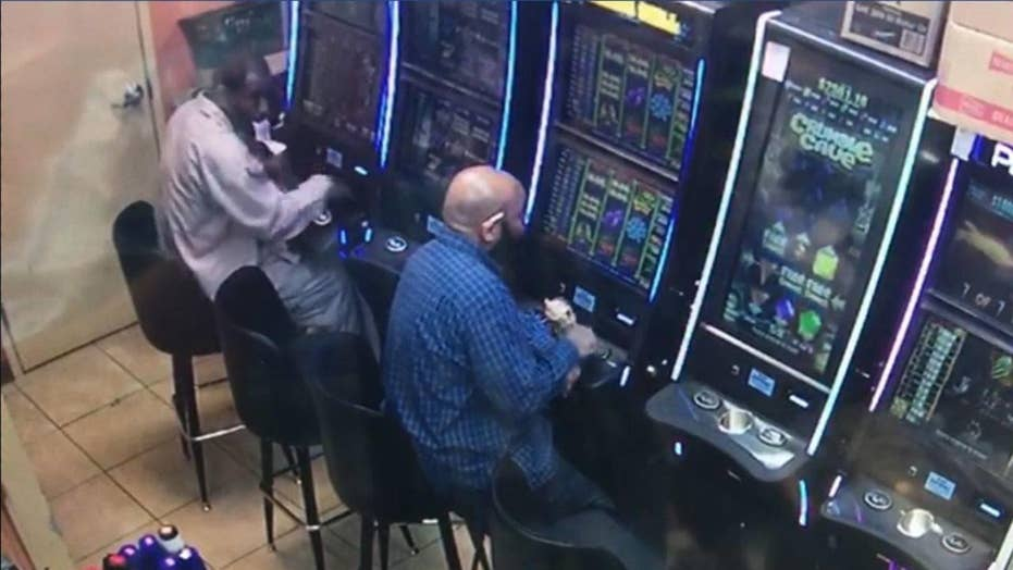 Authorities in Atlanta are searching for a suspect they say stole $7,900 from a gambling machine