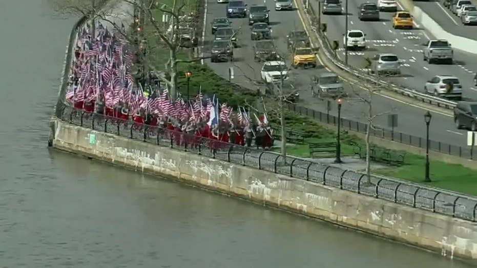 New York firefighters run with french flags in tribute to Notre Dame crews