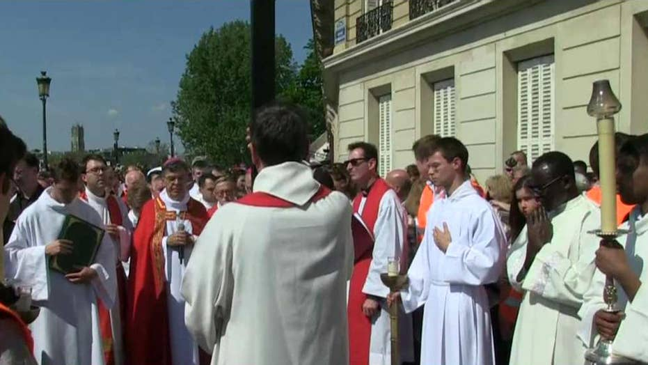 Way of the Cross ritual takes place around Notre Dame Cathedral