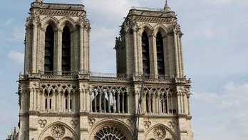 Spire, woodwork fall victim to Notre Dame fire but artifacts are saved