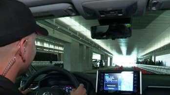 A professional driver takes the Toyota Rav4 through a test track
