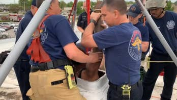 Oklahoma firefighters rescue suspected burglar trapped in chimney for hours